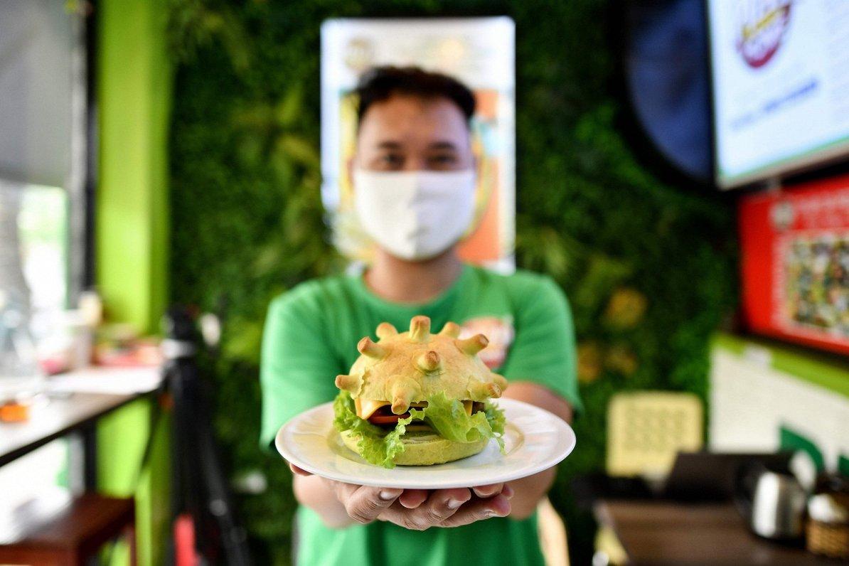 Vjetnamā restorāns klientus piesaista ar burgeriem koronavīrusa formā